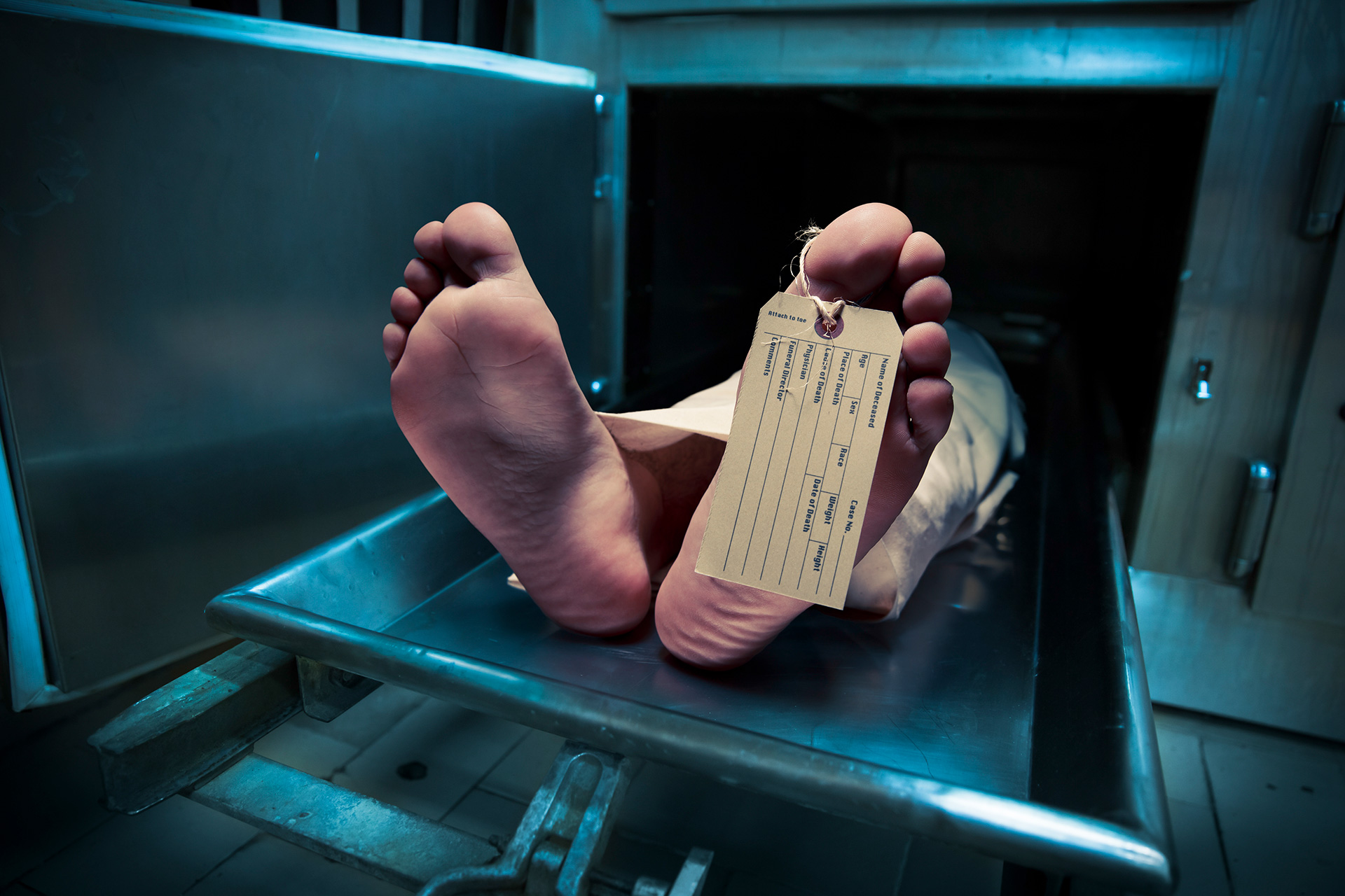 body with toe tag in morgue